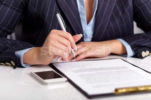 4191305_stock-photo-young-woman-reads-a-signed-contract